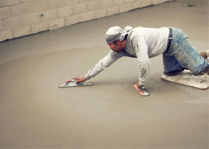 smoothing out the grout in a slab releveling project in Springfield