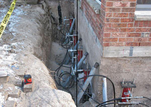 Foundation push piers installed around a house with a foundation settlement issues in Circleville