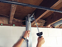 Straightening a foundation wall with the PowerBrace™ i-beam system in a Dublin home.