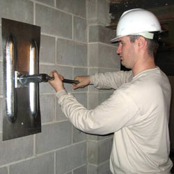 installing a wall anchor to repair an bowing foundation wall in Dublin