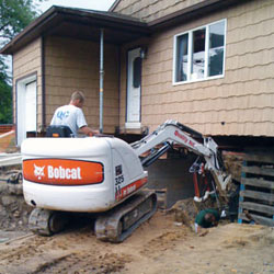 Excavating to expose the foundation walls and footings for a replacement job in Columbus