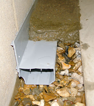 A basement drain system installed in a Springfield home