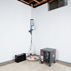 Sump pump system, dehumidifier, and basement wall panels installed during a sump pump installation in Athens